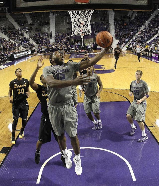 Kansas State's Thomas Gipson (42) puts up a shot during the second half of an NCAA college basketball game against Long Beach State, Sunday, Nov. 17, 2013, in Manhattan, Kan. Kansas State won 71-58. (AP Photo/Charlie Riedel)
