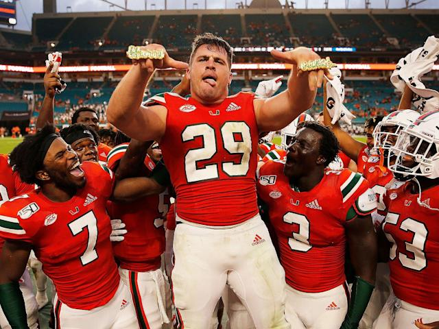 <p>Jimmy Murphy #29 of Miami celebrates with the touchdown rings after a TD against Bethune Cookman during the second half at Hard Rock Stadium on Sept. 14, 2019.</p>