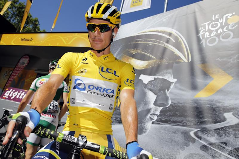 South Africa's Daryl Impey wears the overall leader's yellow jersey before the start of the eightht stage of the Tour de France on July 6, 2013