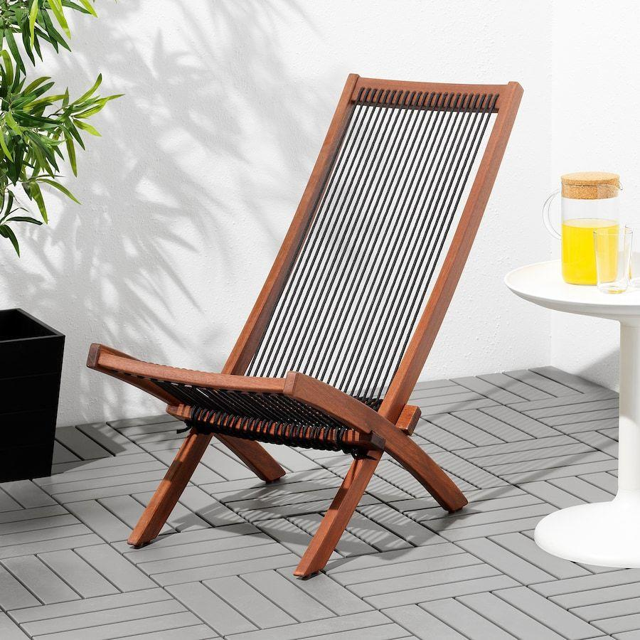 """<p><strong>IKEA</strong></p><p>ikea.com</p><p><strong>$59.99</strong></p><p><a href=""""https://go.redirectingat.com?id=74968X1596630&url=https%3A%2F%2Fwww.ikea.com%2Fus%2Fen%2Fp%2Fbrommoe-chaise-outdoor-black-brown-stained-brown-40332682%2F&sref=https%3A%2F%2Fwww.goodhousekeeping.com%2Fhome-products%2Fg32743125%2Fbest-patio-chairs%2F"""" rel=""""nofollow noopener"""" target=""""_blank"""" data-ylk=""""slk:Shop Now"""" class=""""link rapid-noclick-resp"""">Shop Now</a></p><p>If you're searching for a modern addition for your outdoor area, this sleek wood chair fits the bill.</p>"""