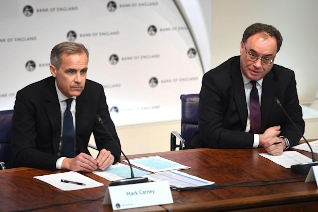 Mark Carney, left, with incoming governor Andrew Bailey. (Peter Summers/AFP via Getty)