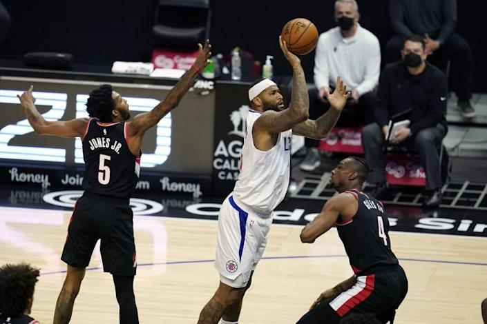Los Angeles Clippers center DeMarcus Cousins, center, shoots against the Portland Trail Blazers during the second half of an NBA basketball game Tuesday, April 6, 2021, in Los Angeles. (AP Photo/Marcio Jose Sanchez)