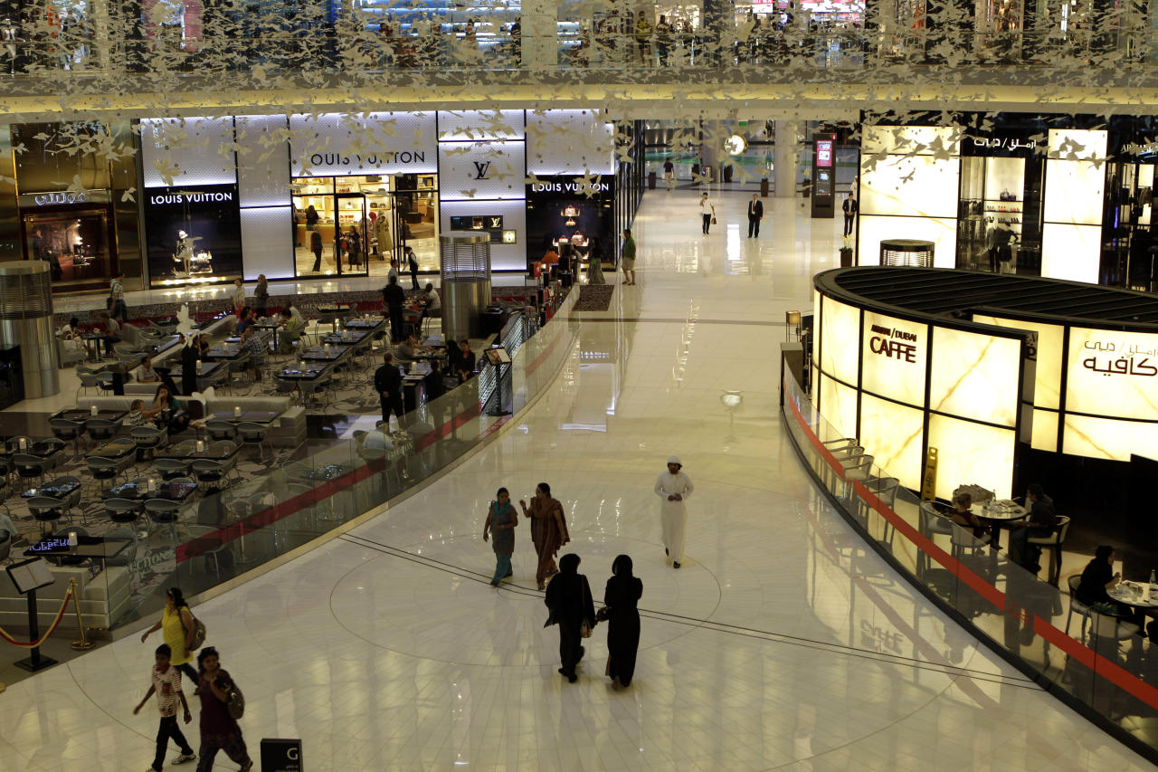 "FILE-- In this Sept. 25, 2012 file photo, people shop in the Dubai Mall, in Dubai, United Arab Emirates. A subsidiary of the state-backed developer Emaar said it made an $800-million offer to purchase the online retailer Souq.com amid rumors of a possible acquisition of the website by Amazon. A stock market filing by Emaar Malls, which runs the Dubai Mall, said the ""bid has still not been accepted by the shareholders of Souq.com."" (AP Photo/Kamran Jebreili, File)"