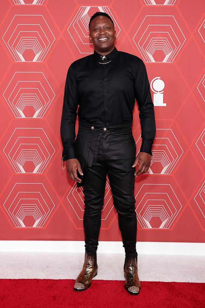 <p>Tituss Burgess wore a black ensemble to the Tony Awards, accessorizing with gold boots. </p>