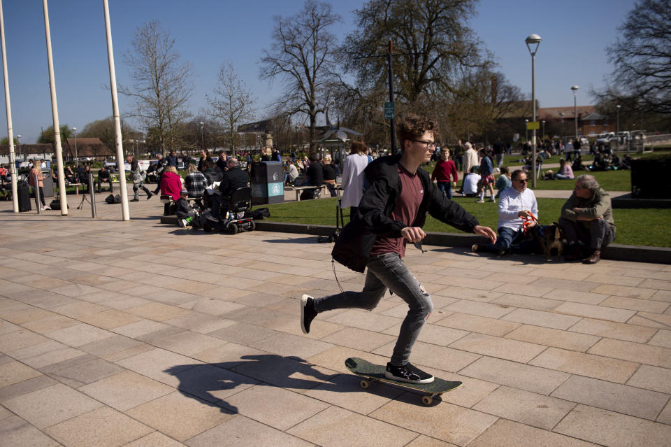 People enjoy a fine spring day in Stratford-upon-Avon, England, Sunday April 4, 2021. During current coronavirus restrictions people are allowed to meet up and exercise in the open air. (Jacob King/PA via AP)