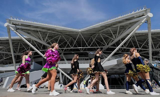 Cheerleaders walk in front of the Samara Arena stadium in Samara, Russia, May 6, 2018. REUTERS/Maxim Shemetov