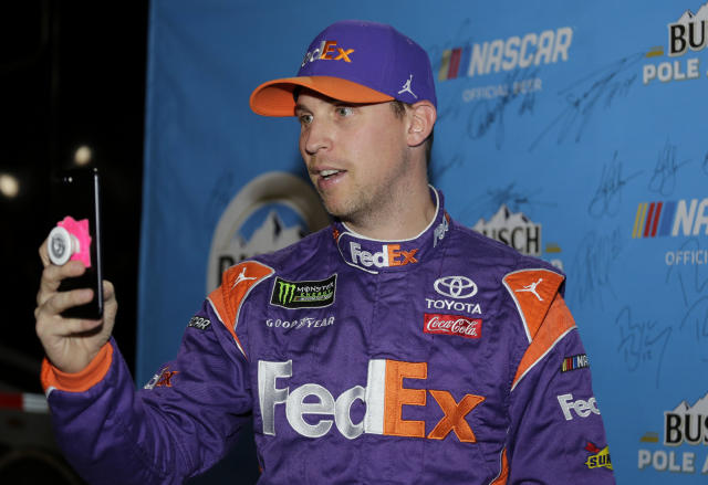 Denny Hamlin takes a selfie after winning the pole position during qualifying for the NASCAR Cup Series auto race at the Homestead-Miami Speedway, Friday, Nov. 16, 2018, in Homestead, Fla. (AP Photo/Terry Renna)