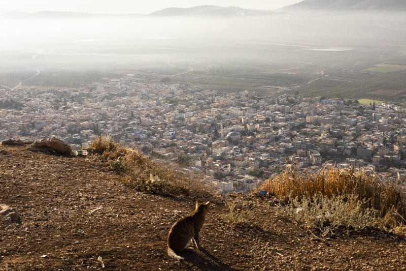 In this Friday, Sept. 27, 2019 photo, a general view of the Israeli Arab village of Iksal near Nazareth, northern Israel. Electoral gains made by Arab parties in Israel, and their decision to endorse one of the two deadlocked candidates for prime minister, could give them new influence in parliament. But they also face a dilemma dating back to Israel's founding: How to participate in a system that they say relegates them to second-class citizens and oppresses their Palestinian brethren in Gaza and the occupied West Bank. (AP Photo/Oded Balilty)