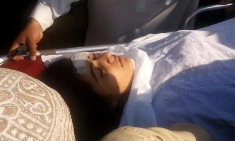 Malala Yousufzai, a 14-year-old Pakistani activist, is moved to a helicopter to be taken to Peshawar for treatment, after being shot and wounded by a member of the Taliban on Oct. 9.