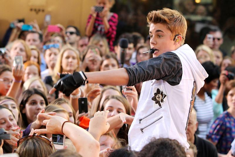 """This image released by Starpix shows singer Justin Bieber performing on the """"Today"""" show as part of their summer concert series in Rockefeller Center, Friday, June 15, 2012 in New York. (AP Photo/Starpix, Amanda Schwab)"""