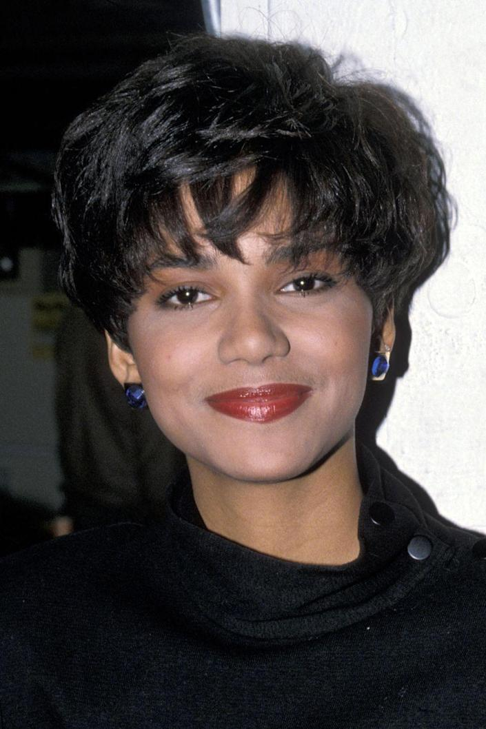 <p>Earlier in her career, the Oscar winner wore her usually-short hairstyle in her natural dark brown shade.</p>