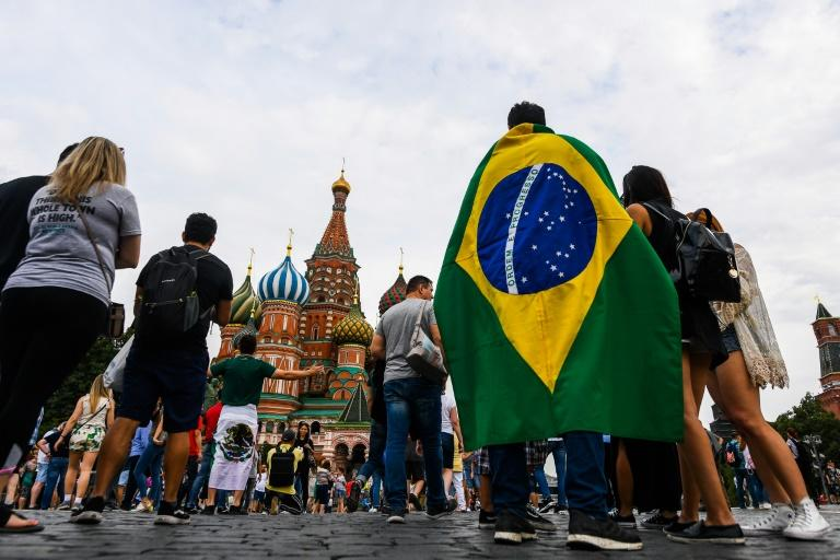 A Brazil fan joins the crowds gathering in Moscow's Red Square, a focal point for visitors to Russia for the World Cup