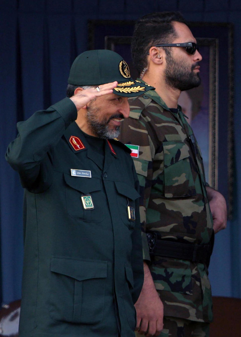 FILE - In this Sunday, Nov. 26, 2006, file photo, Brig. Gen. Mohammad Hosseinzadeh Hejazi salutes in a military parade in Tehran, Iran. Brig. Gen. Hejazi, deputy commander of the Quds, or Jerusalem, force of Iran's paramilitary Revolutionary Guard, has died, the Guard Corps announced on Sunday, April 18, 2021. The unit is an elite and influential group that oversees foreign operations, and Hejazi helped lead its expeditionary forces and frequently shuttled between Iraq, Lebanon and Syria. (AP Photo/Vahid Salemi, File)