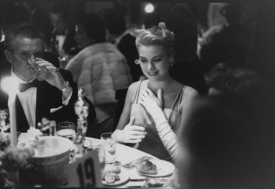 Actress Grace Kelly  with her Oscar for Best Actress (for 'The Country Girl'), at Romanoff's restaurant, following the 27th annual Academy Awards presentation at the RKO Pantages Theatre, Hollywood.  (Photo by George Silk/The LIFE Picture Collection via Getty Images)