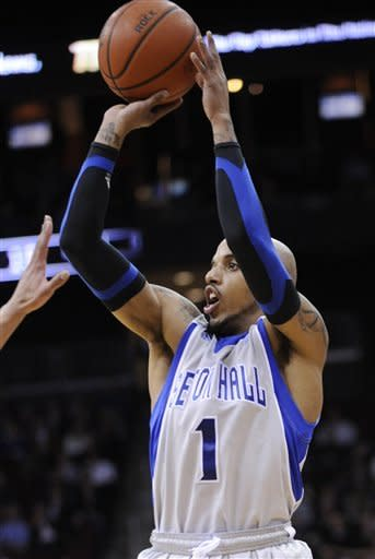 Seton Hall's Jordan Theodore takes a shot during the first half of an NCAA college basketball game against Georgetown, Tuesday, Feb. 21, 2012, in Newark, N.J. Theodore led all scorers with 29 points as Seton Hall defeated Georgetown 73-55. (AP Photo/Bill Kostroun)