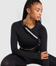 "<p><strong>gymshark womens</strong></p><p>gymshark.com</p><p><strong>$15.00</strong></p><p><a href=""https://www.gymshark.com/products/gymshark-running-belt-black"" rel=""nofollow noopener"" target=""_blank"" data-ylk=""slk:Shop Now"" class=""link rapid-noclick-resp"">Shop Now</a></p><p>You can either wear this one across your chest or around your waist. Either way, it's a sleek place to stash your phone.</p>"