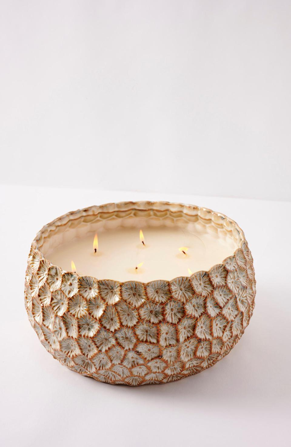 """<p><strong>ANTHROPOLOGIE HOME</strong></p><p>nordstrom.com</p><p><strong>$89.90</strong></p><p><a href=""""https://go.redirectingat.com?id=74968X1596630&url=https%3A%2F%2Fshop.nordstrom.com%2Fs%2Fanthropologie-home-medium-honeycomb-scented-candle%2F5570186&sref=https%3A%2F%2Fwww.veranda.com%2Fluxury-lifestyle%2Fg33484341%2Fnordstrom-anniversary-sale-2020%2F"""" rel=""""nofollow noopener"""" target=""""_blank"""" data-ylk=""""slk:Discover"""" class=""""link rapid-noclick-resp"""">Discover</a></p><p>This candle makes a statement with its charming honeycomb design. With notes of tonka and tobacco leaf, this is the perfectly balanced candle for every nose in your home. </p>"""