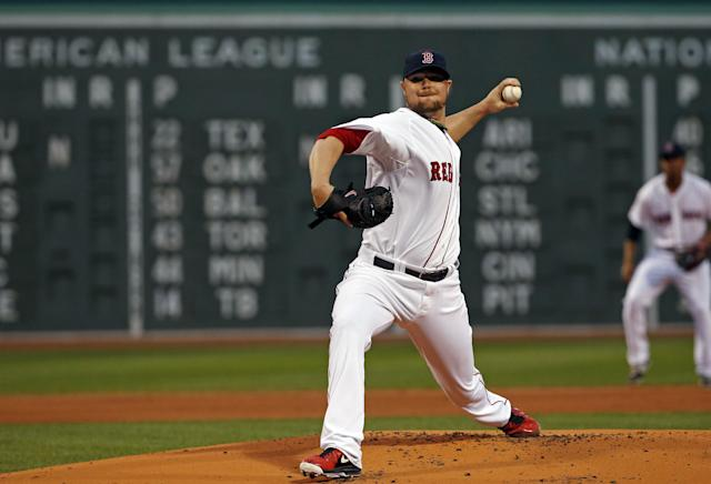 Boston Red Sox starting pitcher Jon Lester delivers to the New York Yankees during the first inning of a baseball game at Fenway Park in Boston, Tuesday, April 22, 2014. (AP Photo/Elise Amendola)