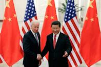 Chinese President Xi Jinping (R) shakes hands with US Vice President Joe Biden (L) inside the Great Hall of the People in Beijing on December 4, 2013