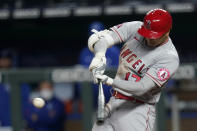 Los Angeles Angels designated hitter Shohei Ohtani hits a two-run double during the seventh inning of a baseball game against the Kansas City Royals at Kauffman Stadium in Kansas City, Mo., Monday, April 12, 2021. (AP Photo/Orlin Wagner)