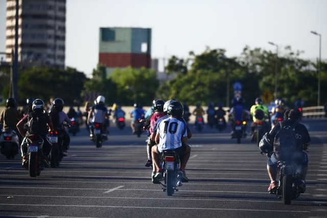 The hearse carrying Diego Maradona's body was followed by fans on its way to the cemetery in Buenos Aires