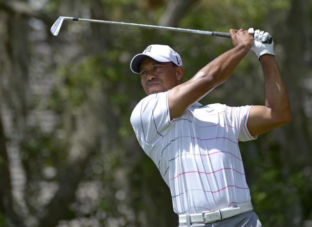 Tiger Woods hits a shot on the fifth hole during the second round of the Arnold Palmer Invitational golf tournament at Bay Hill, Friday, March 23, 2012, in Orlando, Fla. (AP Photo/Phelan M. Ebenhack)