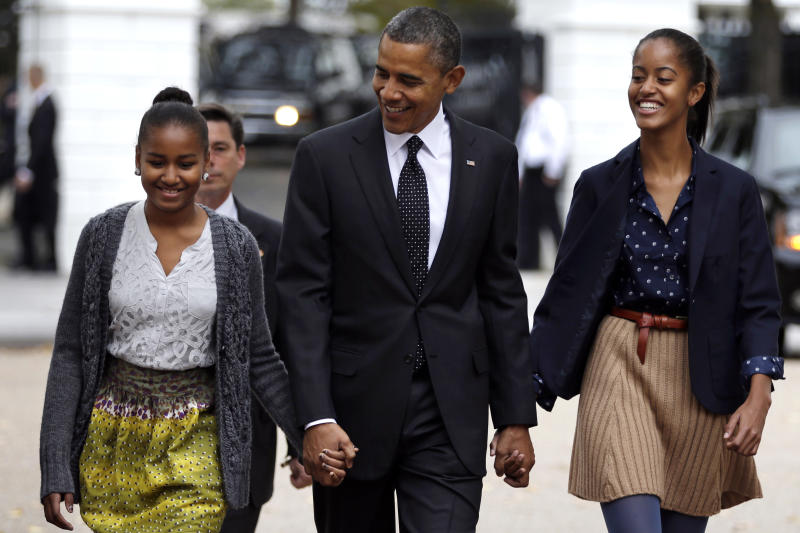 President Barack Obama walks to St. John's Episcopal Church from the White House with his daughters Sasha, left, and Malia, in Washington, on Sunday, Oct. 28, 2012.  (AP Photo/Jacquelyn Martin)
