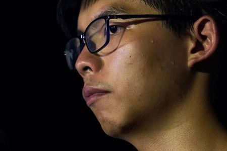 """Drops of sweat roll down on the cheek of Hong Kong student leader Joshua Wong as he attends a rally against """"the cooperation of three powers"""", a day before an appeal verdict on charges relating to 2014 pro-democracy, also known as """"Occupy Central"""", protests, in Hong Kong, China August 16, 2017. REUTERS/Tyrone Siu"""