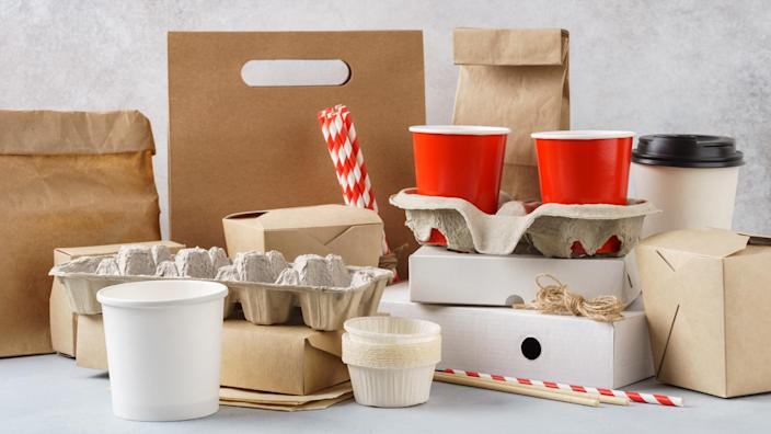 Set of various eco friendly packaging, disposable recyclable containers and tableware.