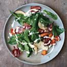 """This dish flips conventional Southern cookery on its head. Rather than cooking greens into submission, they're quickly brined to soften their texture and mellow their bitterness, then married with the sweet, salty, and creamy elements of a composed salad. <a href=""""https://www.epicurious.com/recipes/food/views/wilted-greens-salad-with-squash-apples-and-country-ham-388731?mbid=synd_yahoo_rss"""" rel=""""nofollow noopener"""" target=""""_blank"""" data-ylk=""""slk:See recipe."""" class=""""link rapid-noclick-resp"""">See recipe.</a>"""