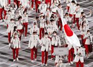 <p>TOKYO, JAPAN JULY 23, 2021: Delegation from Japan takes part in the Parade of Nations at the opening ceremony of the Tokyo 2020 Summer Olympic Games at the National Stadium. Tokyo was to host the 2020 Summer Olympics from 24 July to 9 August 2020, however because of the COVID-19 pandemic the games have been postponed for a year and are due to take place from 23 July to 8 August 2021. Stanislav Krasilnikov/TASS (Photo by Stanislav Krasilnikov\TASS via Getty Images)</p>