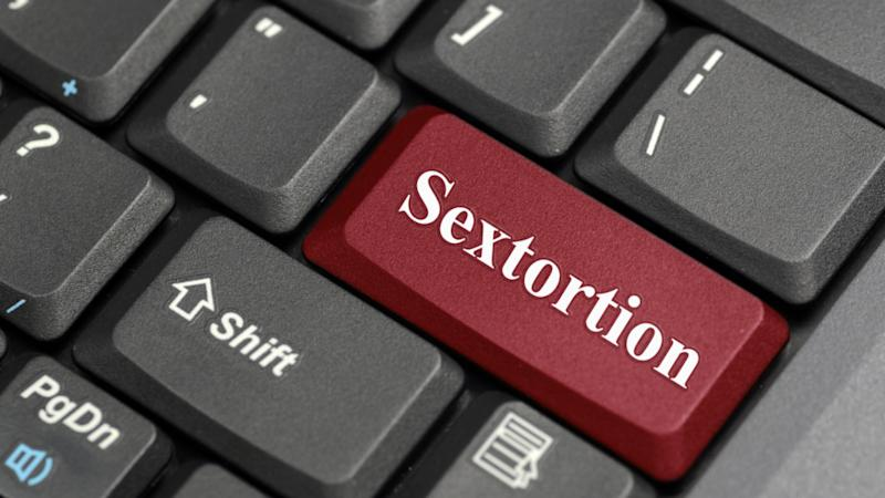 """A keyboard with a red key that's labelled """"sextortion""""."""
