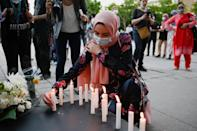 People attend a vigil in memory of a Muslim family in Montreal