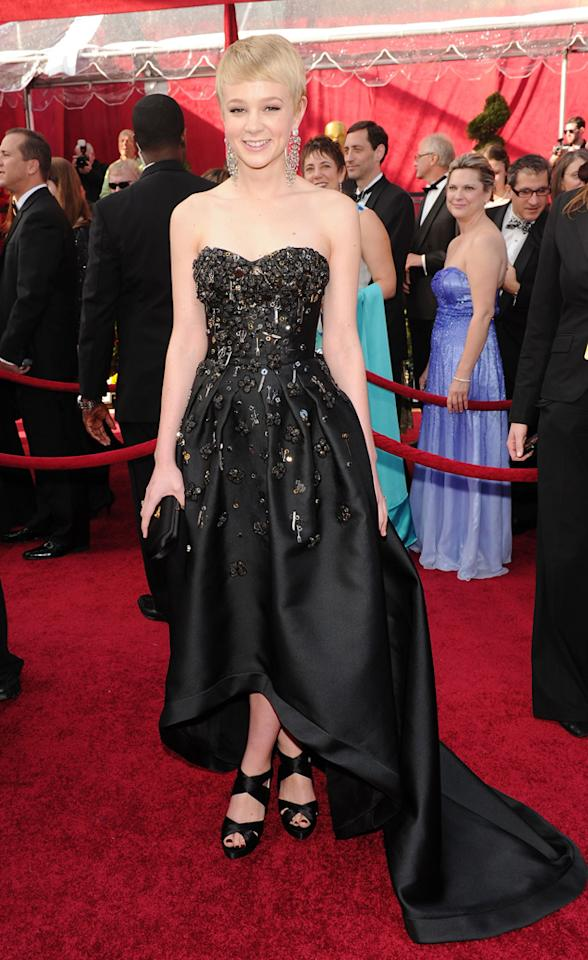 Carey Mulligan   Grade: B-    At first glance, we adored the Best Actress ingenue's interesting Prada frock, which was embellished with Swarovski crystal flowers, forks, knives, scissors, and other random trinkets. But upon closer inspection, the everything-but-the-kitchen-sink gown's asymmetrical line seemed to detract from its beauty.