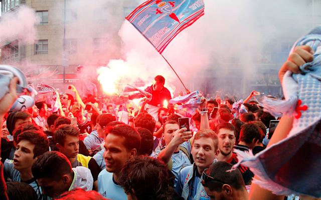 <span>Celta Vigo supporters cheer for their team before the match</span> <span>Credit: EFE </span>