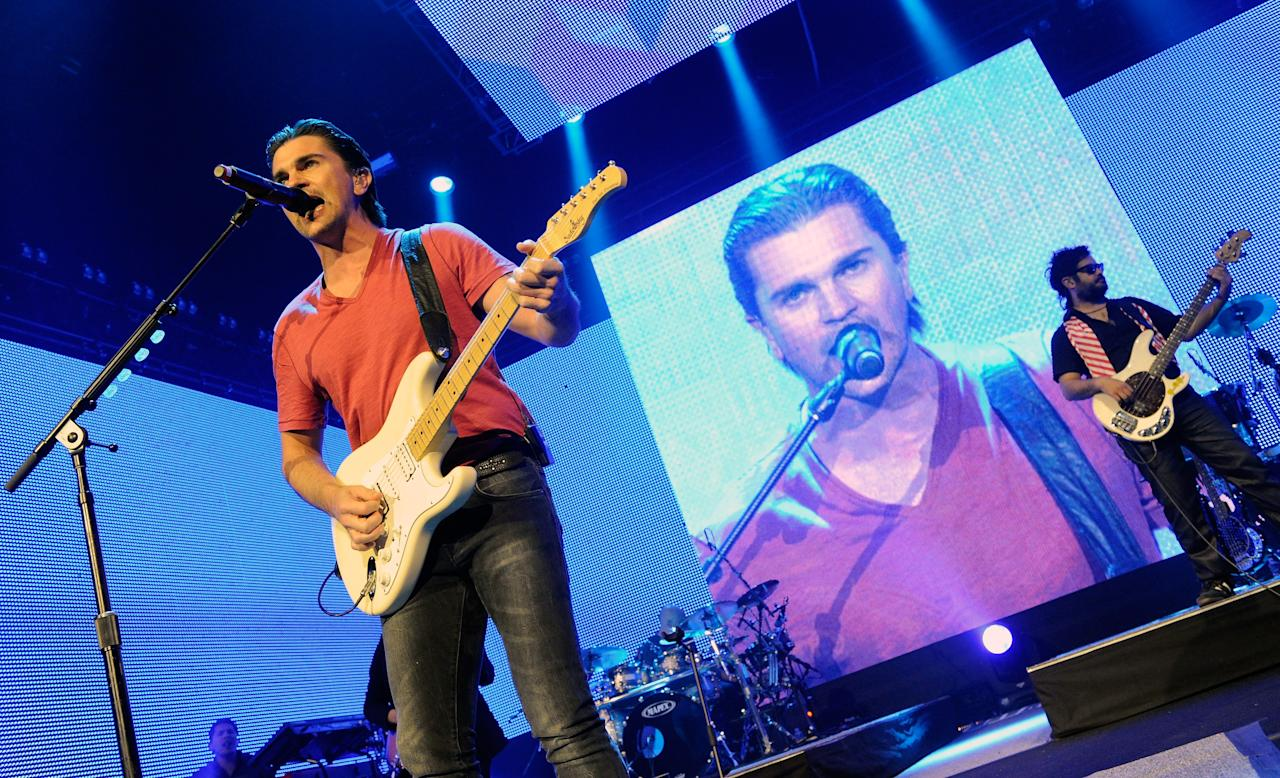 """LAS VEGAS, NV - MARCH 18:  Columbian singer/songwriter Juanes performs at The Joint inside the Hard Rock Hotel & Casino as he tours in support of his latest album,""""P.A.R.C.E."""" March 18, 2011 in Las Vegas, Nevada.  (Photo by Ethan Miller/Getty Images)"""