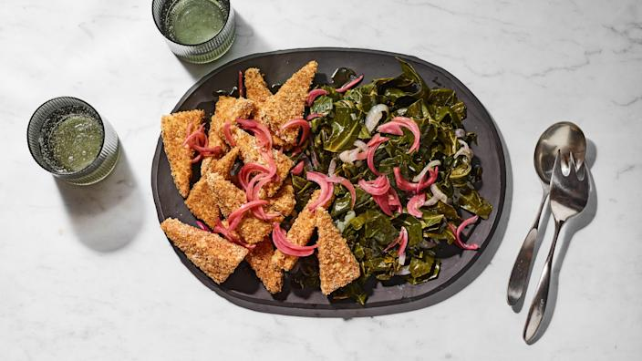 """This easy dinner is inspired by gomen, an Ethiopian dish in which greens are flavored with an aromatic spiced butter called <a href=""""https://www.epicurious.com/recipes-menus/niter-kibbeh-herbs-spices-article?mbid=synd_yahoo_rss"""" rel=""""nofollow noopener"""" target=""""_blank"""" data-ylk=""""slk:niter kibbeh"""" class=""""link rapid-noclick-resp"""">niter kibbeh</a>. Crispy breaded tofu is a delightful counterpoint; topping with pickled onions brightens up the whole dish. <a href=""""https://www.epicurious.com/recipes/food/views/sheet-pan-collard-greens-crispy-tofu-niter-kibbeh?mbid=synd_yahoo_rss"""" rel=""""nofollow noopener"""" target=""""_blank"""" data-ylk=""""slk:See recipe."""" class=""""link rapid-noclick-resp"""">See recipe.</a>"""