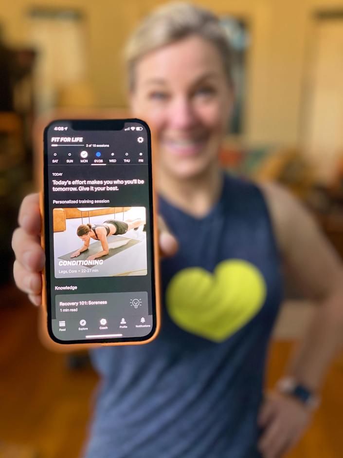 Consumer tech journalist Jennifer Jolly with the Freeletics app, which uses artificial intelligence to personalize fitness.