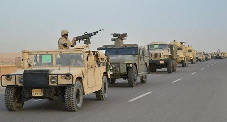 Egyptian Army's Armoured Vehicles are seen on a highway to North Sinai during a launch of a major assault against militants, in Ismailia