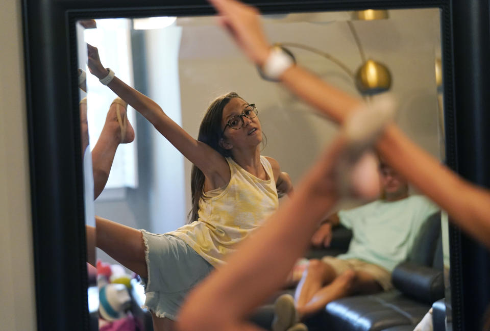 Cecilia Shaffette practices her dance routine in front of her father Rhett Shaffette at their home in Carriere, Miss., Wednesday, June 16, 2021. (AP Photo/Gerald Herbert)