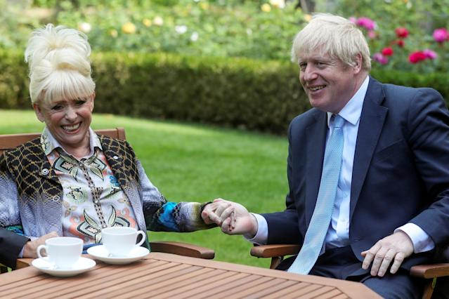 Prime Minister Boris Johnson has a cup of tea with television actress Dame Barbara Windsor during a meeting in London on September 2, 2019 in London, England. (Photo by Simon Dawson - WPA Pool/Getty Images)