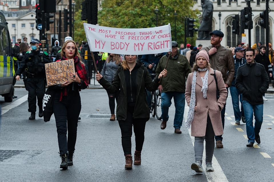Demonstrators take part in Unite for Freedom march along Whitehall to protest against the restrictions and legislations imposed by the Government to control the spread of coronavirus, lockdowns, mandatory face masks and vaccines, on 24 October, 2020 in London, England. (Photo by WIktor Szymanowicz/NurPhoto via Getty Images)