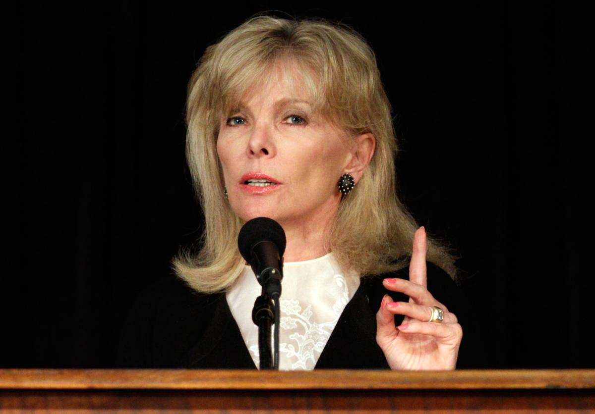 Wall Street executive Darla Moore, known for breaking gender barriers, bypassed another one when she and former Secretary of State Condoleezza Rice got invited to the Augusta National Golf Club. (Brett Flashnick/AP Photo)