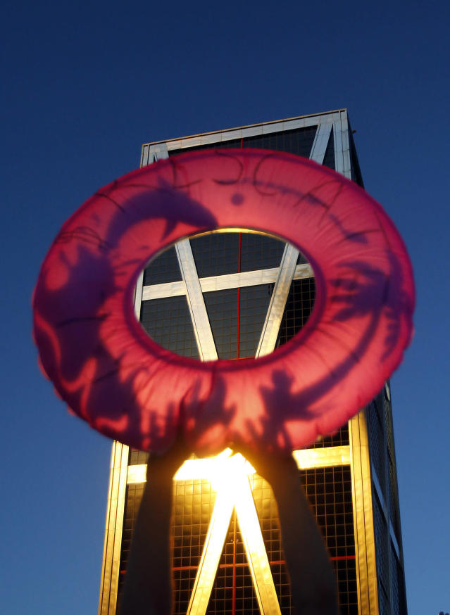 <p>A demonstrator holds up a life preserver during a protest against Bankia at corporate headquarters in Madrid, June 16, 2012. (AP Photo/Andres Kudacki) </p>