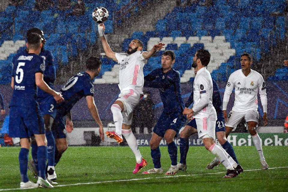 Karim Benzema prepares to volley home in the rain