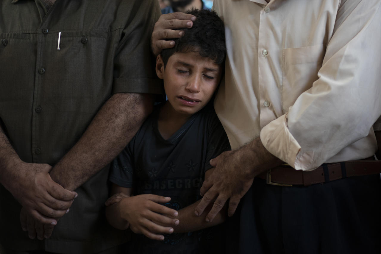 """In this Sept. 15, 2018 photo, 11-year-old Mahmoud Abdel-al, cries during the funeral of his twin brother Shady Abdel-al in Beit Lahiya, northern Gaza Strip. Though the Health Ministry initially reported Abdel-al was shot by Israeli fire, the Israeli army claimed he was accidentally struck by a rock thrown by protesters. Two Gaza rights groups say he died after being hit """"with a solid object."""" (AP Photo/Felipe Dana)"""