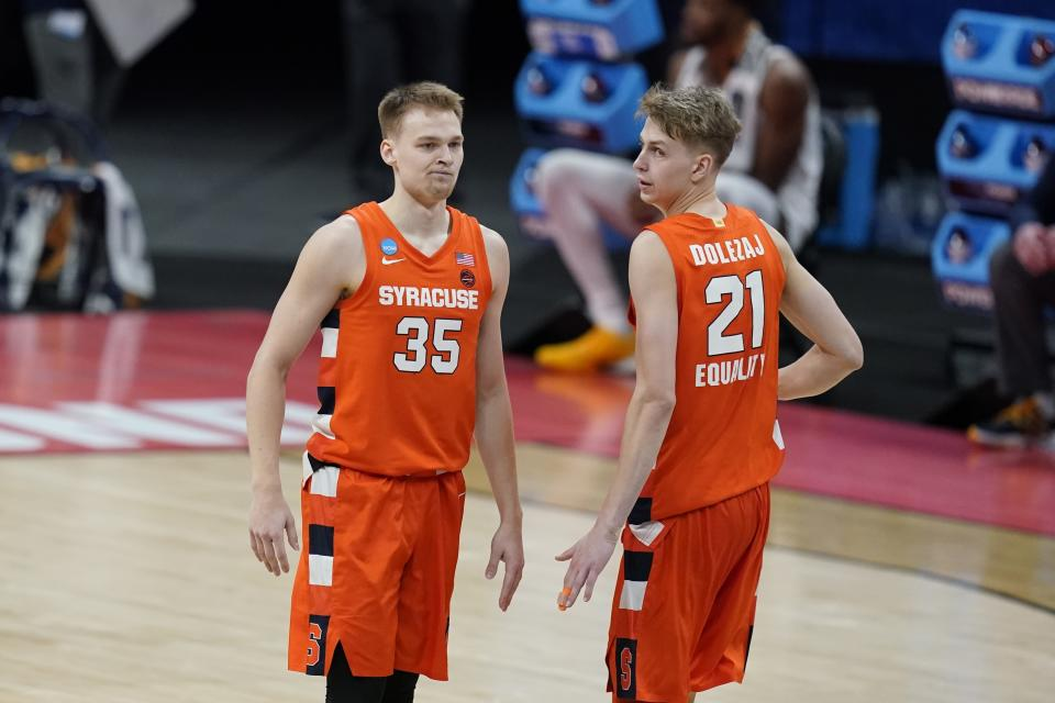 Syracuse's Buddy Boeheim (35) and Marek Dolezaj (21) in action during the second half of a second-round game against West Virginia in the NCAA men's college basketball tournament at Bankers Life Fieldhouse, Sunday, March 21, 2021, in Indianapolis. (AP Photo/Darron Cummings)