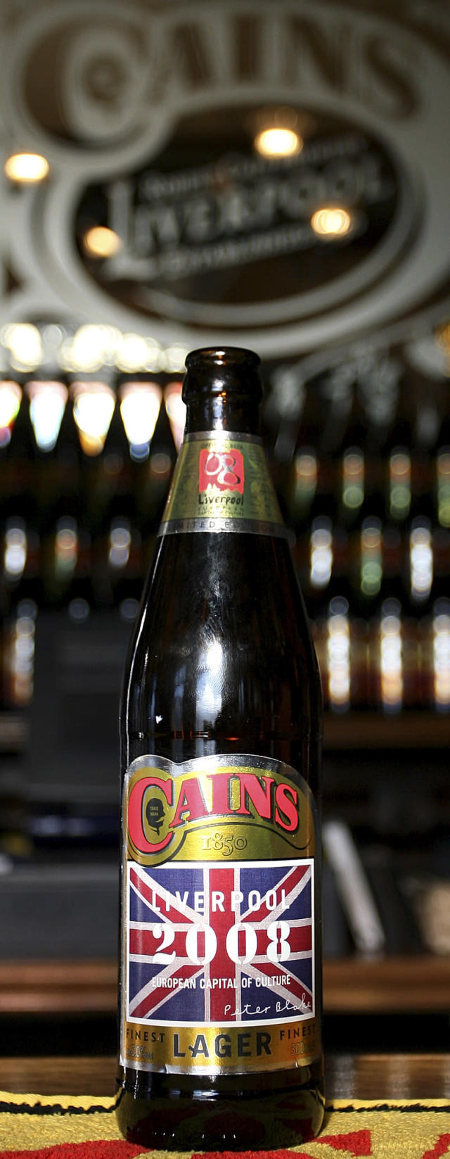 A Cains' Best of British lager bottles with a label designed by British artist Peter Blake, featuring the British flag and his signature, is seen at a pub in Liverpool, England, Friday Feb. 11, 2008. Blake, who created the The Beatles' Sgt. Pepper's Lonely Hearts Club Band album cover, has designed a beer bottle label to celebrate Liverpool's European Capital of Culture year. Cains Beer, based in Toxteth, Liverpool, plans to produce 250,000 bottles until December. (AP Photo/Paul Thomas)