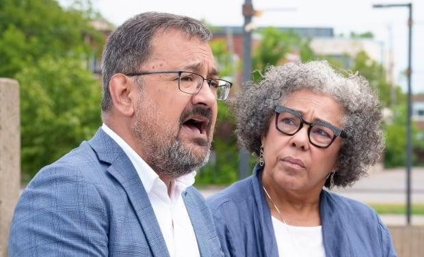 Quebec Solidaire MNA Andres Fontecilla (left) and Marjorie Villefranche, director of La Maison d'Haiti (right) say the province should develop a policy to control police behaviour around young Black students. (Paul Chiasson/The Canadian Press - image credit)