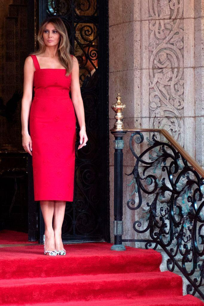 <p>The First Lady prepared to meet Chinese President Xi Jinping and his wife for a formal dinner at Mar-a-Lago. She wore a $5,500 Valentino dress with daisy accents, which she shortened from its original ankle-length hemline. She chose to wear the color red, traditionally symbolizing good fortune in Chinese culture.</p>